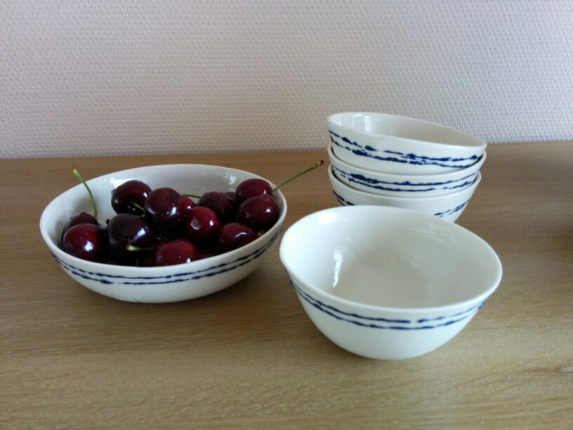 cherries in porcelain bowl